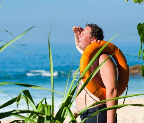 Name search man on beach tiny